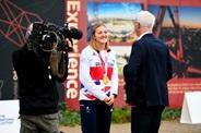 Ellen speaking to a journalist with her medal around her neck