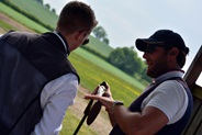 British shooting coach, Lee Campion working with an athlete in the shooting range