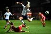 Alex Greenwood gets tackled