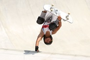 Sky Brown doing a skateboard trick at the Tokyo Games